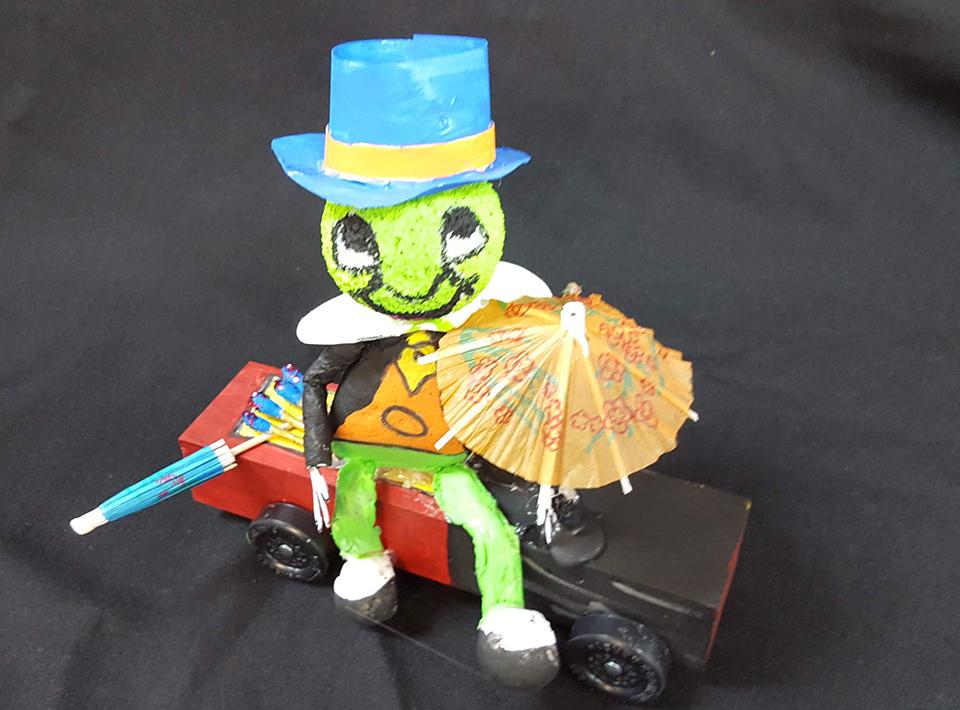 a race car designed like Jimmeny Cricket of Walt Disney fame