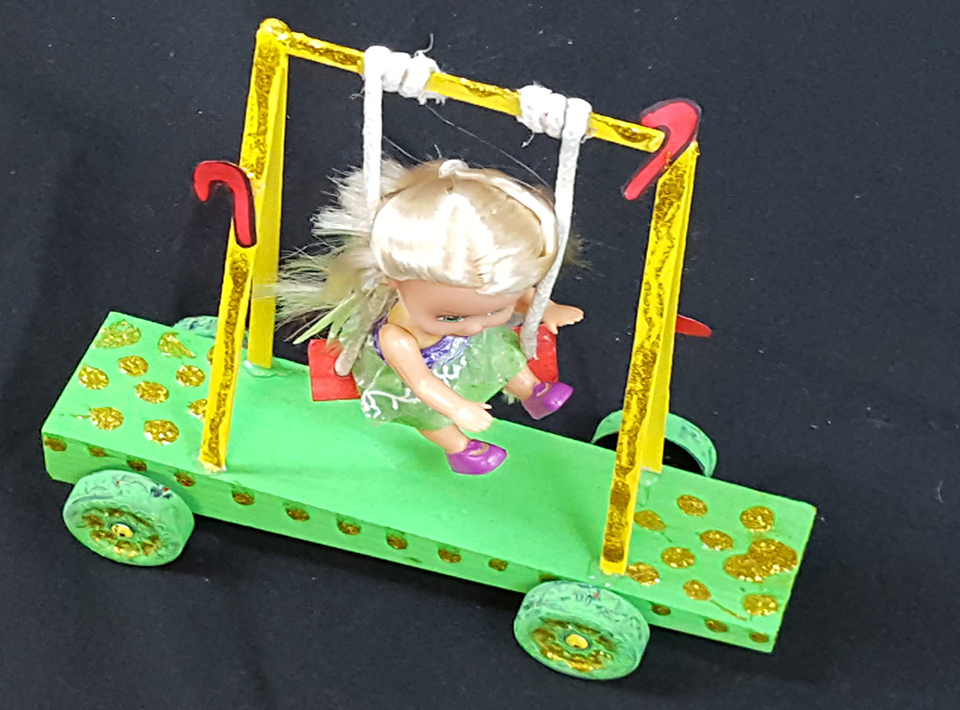 Katie Timmer's car sponsored by her father. Shows little girl on a swing
