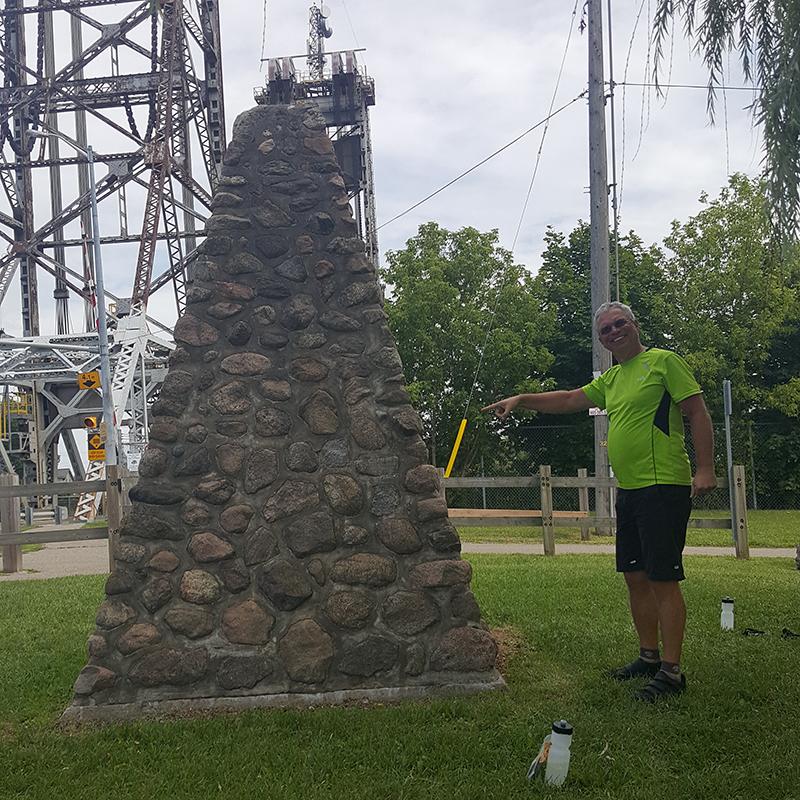 A rider standing next to rock pyramid near Niagra Falls